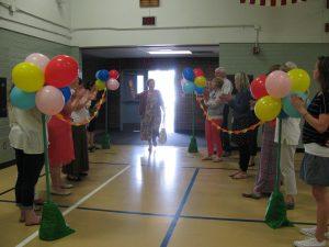Volunteer walking through celebration line